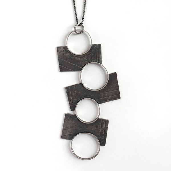 Four Pools Pendant by Jane Pellicciotto. Sterling silver.