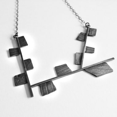 Asymmetrical, angular sterling silver necklace with textured fragments. Jane Pellicciotto