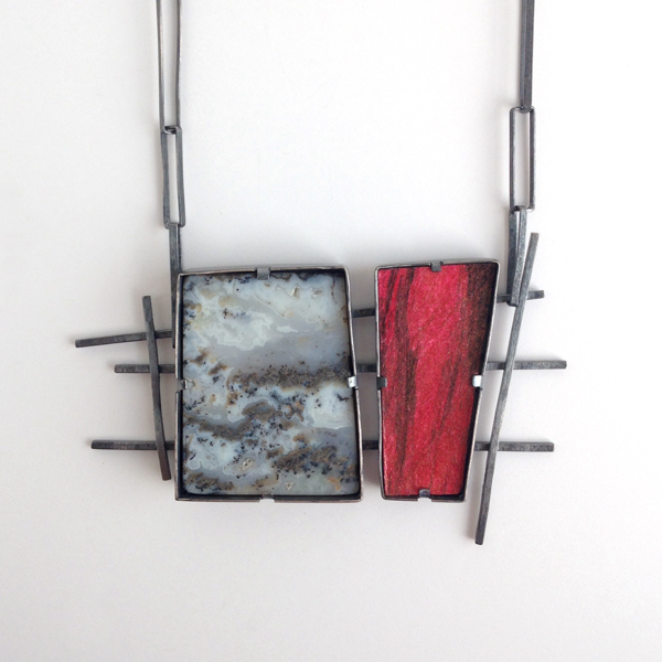 Double wedge necklace by Jane Pellicciotto. Sterling silver, moss agate, acrylic on paper.