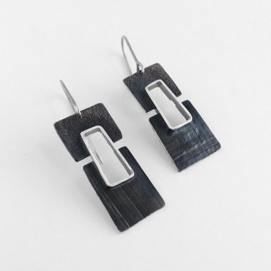Textured and oxidized two-toned sterling silver earrings. Jane Pellicciotto