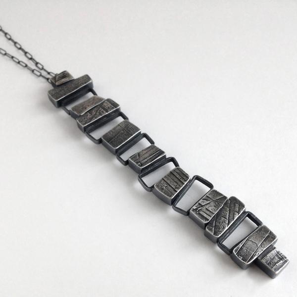 Totem pendant. Jane Pellicciotto. Sterling silver.