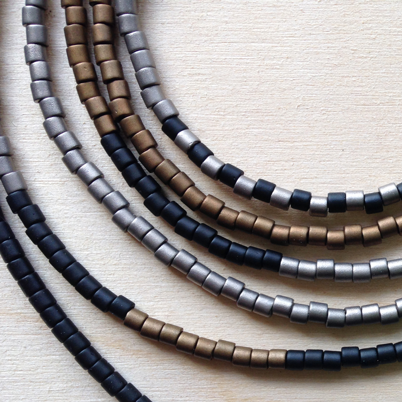 Rhythm Necklace with Japanese glass beads in neutral tones. Sterling silver handmade toggle clasp. Jane Pellicciotto