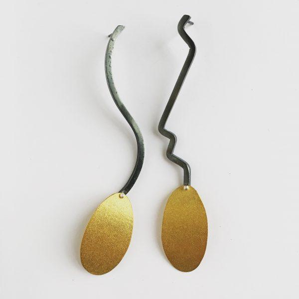 Mismatching bimetal earrings by Jane Pellicciotto