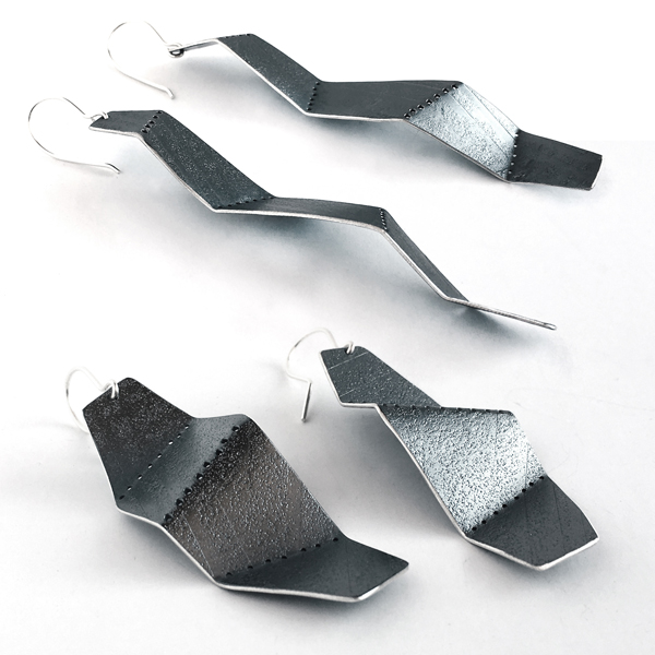 Perforated and folded sterling silver earrings. Jane Pellicciotto