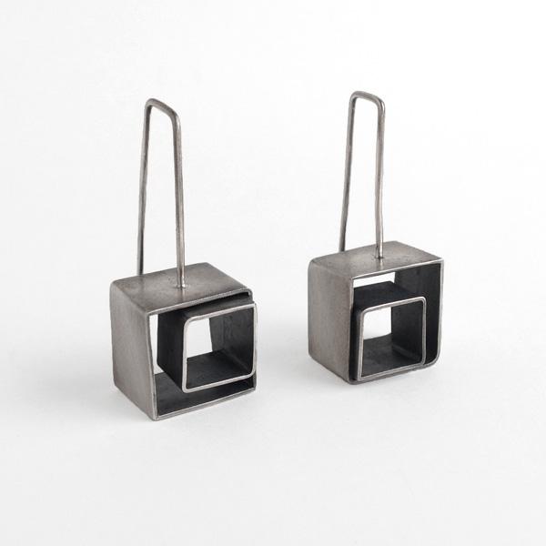Cubes Squared Earrings | Sterling silver two-toned nested cubes. Jane Pellicciotto
