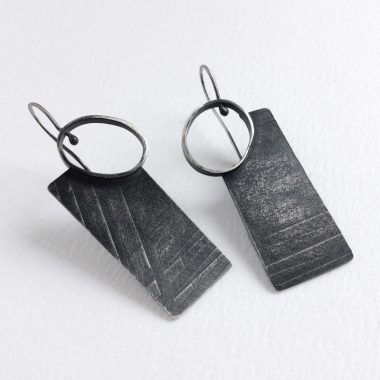 Rectangle Portal Earrings | Architectural earrings with surface texture and oval opening. Oxidized sterling silver | Jane Pellicciotto