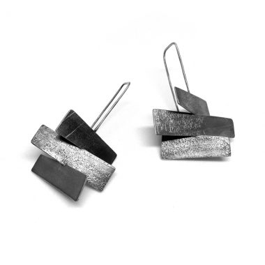 Wayward Earrings | Oxidized sterling silver with multidirectional textured wedge shape. Jane Pellicciotto