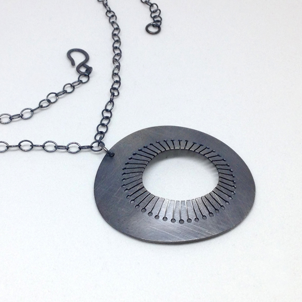 Sterling silver oxidized necklace with round pendant. Jane Pellicciotto