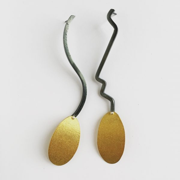 Mismatching bimetal earrings by Jane Pellicciotto