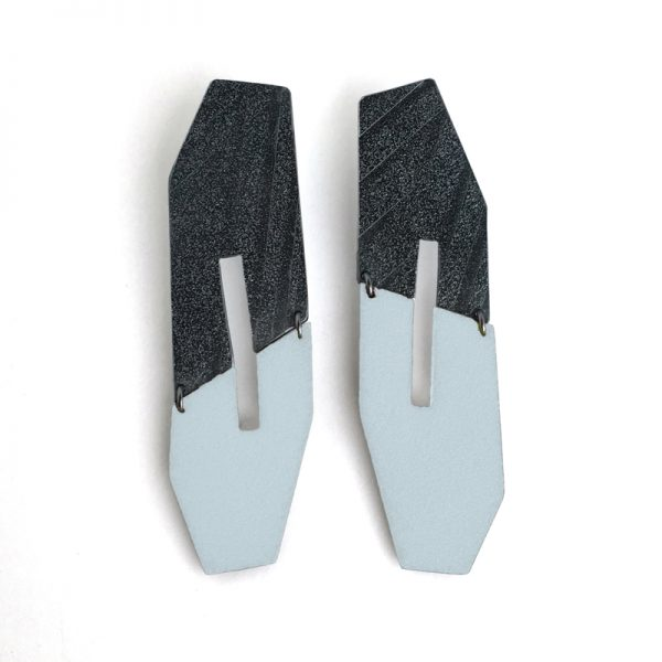 Oxidized sterling silver and ice blue enamel statement earrings. Jane Pellicciotto