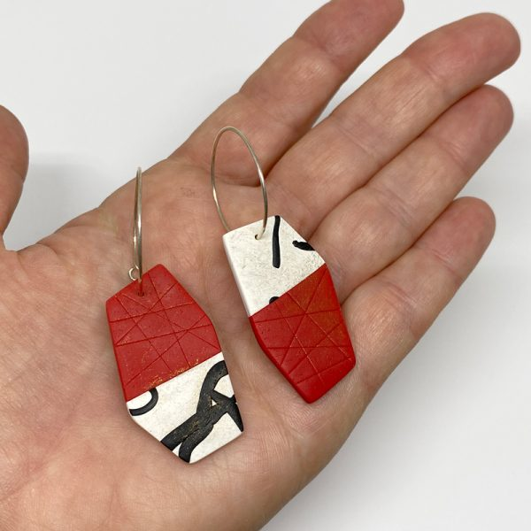 Red, black and white calligraphy hoop earrings. Jane Pellicciotto