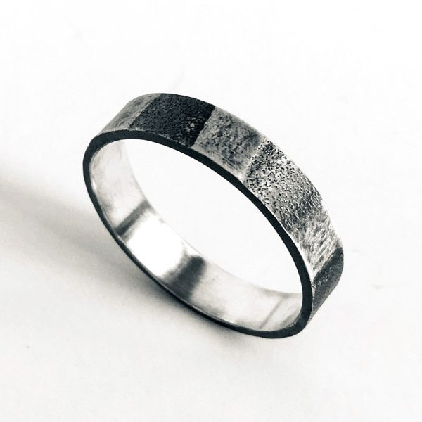 Sterling silver striped textured band ring. Jane Pellicciotto