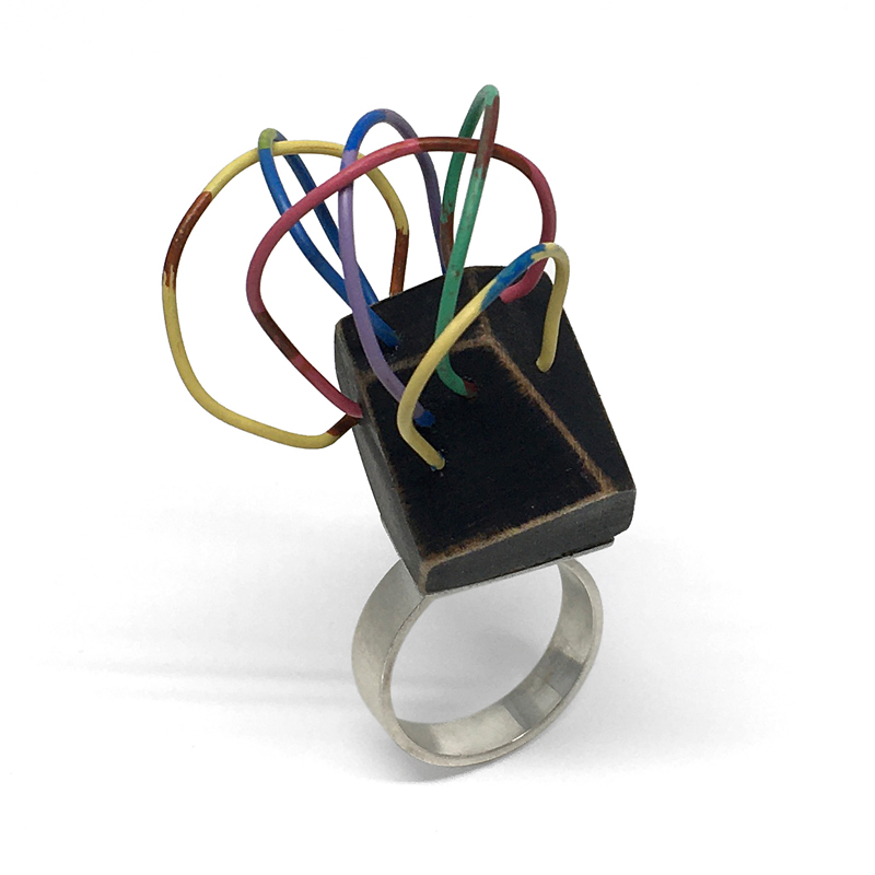 Faceted wood ring with vintage electrical wire and sterling silver. Jane Pellicciotto
