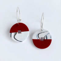 Red and white disc earrings.