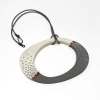 Textured, stitched oval polymer clay pendant. Jane Pellicciotto