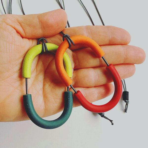 Double Arcata Pendant. Polymer clay, sterling silver, nylon cord. Jane Pellicciotto
