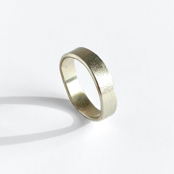 Sterling silver sand-textured band. Jane Pellicciotto