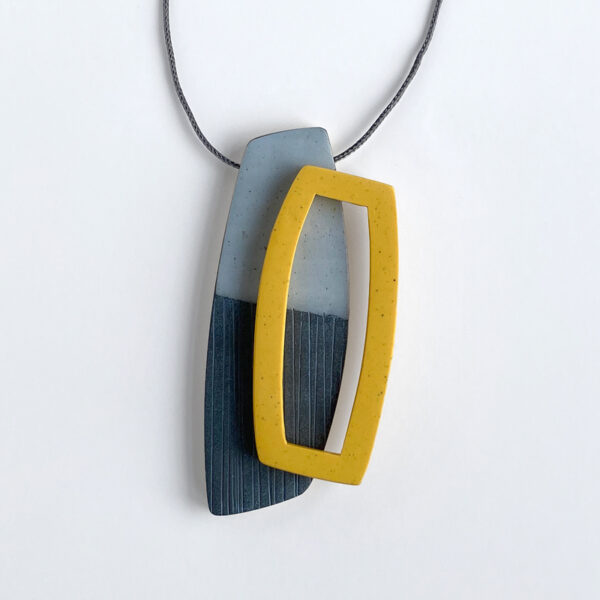 Layered petal pendant in yellow and gold. Polymer clay and nylon cord. Jane Pellicciotto