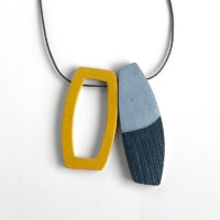 Layered batteau pendant in yellow and gold. Polymer clay and nylon cord. Jane Pellicciotto