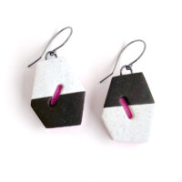 Angular polygon earrings in pink and brown with cutout window. Jane Pellicciotto
