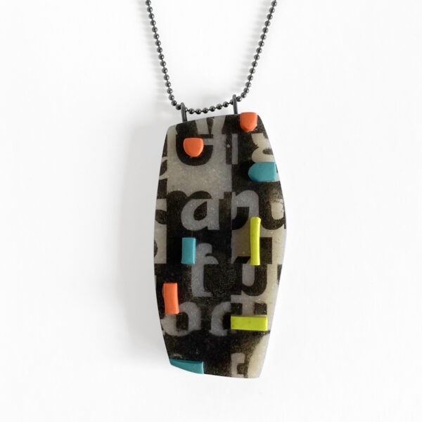 Typographic collage pendant. Polymer clay, sterling silver chain. Jane Pellicciotto