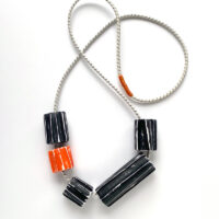 Sculptural polymer clay chunky beads on bungee cord. Jane Pellicciotto