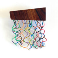 Wood and telephone wire brooch. Jane Pellicciotto