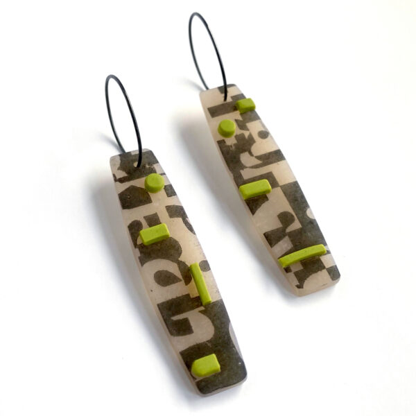 Type collage earrings with green accents. Polymer clay and sterling silver. Jane Pellicciotto