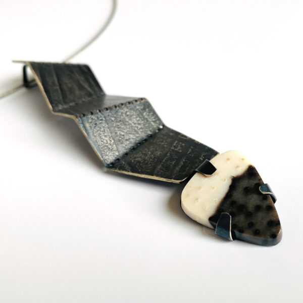 Folded pendant with petrified palmwood. Sterling silver. Jane Pellicciotto