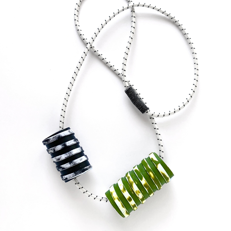 Chunky spiral bead necklace. Polymer clay with acrylic paint, bungee cord. Jane Pellicciotto