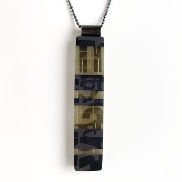 Striped typography pendant with gold dust and green accent. Jane Pellicciotto